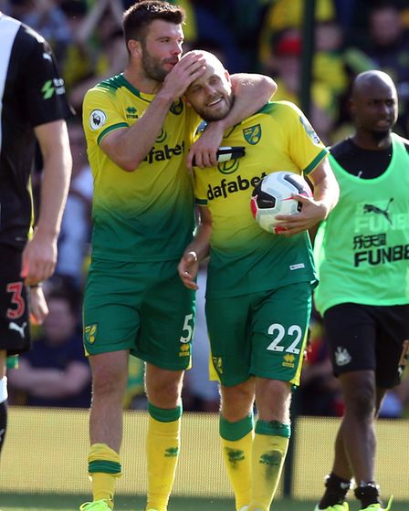 His finest moment? Teemu Pukki gets a hug from Grant Hanley after scoring a hat-trick against Newcas