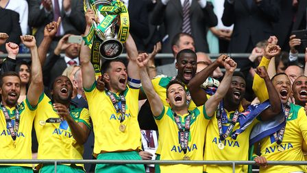 Russell Martin lifts the Championship play-off final trophy after beating Middlesbrough in 2015 at W