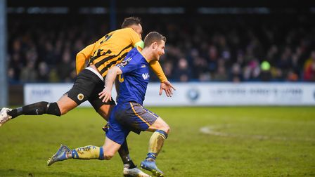 Adam Marriott in action at Boston - this challenge earned Luke Shiels a red card. Picture: Ian Burt