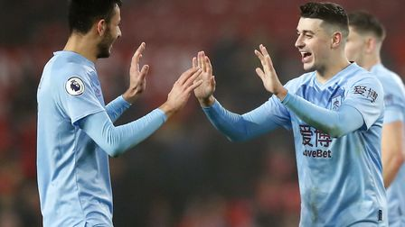 Burnley's Dwight McNeil (left) and Matthew Lowton celebrate victory at Manchester United on Wednesda