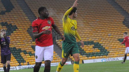 Canaries striker Tom Dickson-Peters claims for a corner Picture: Tony Thrussell