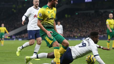 Lukas Rupp battles with Spurs left-back Ryan Sessegnon during his full Norwich City debut Picture: P