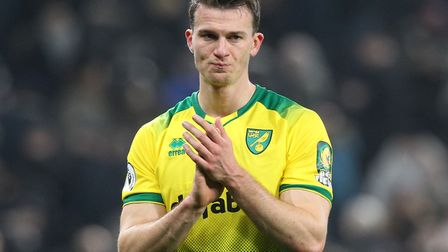 Christoph Zimmermann of Norwich applauds the traveling support at the end of the Premier League matc