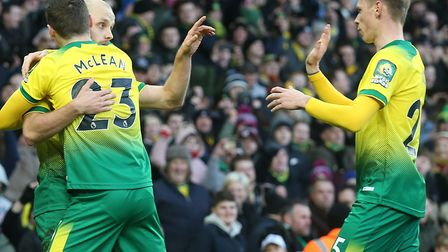 Teemu Pukki thanks Ondrej Duda, right, after scoring his penalty to give Norwich the lead against Bo