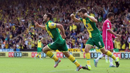 Matt Jarvis, left, and Jonny Howson celebrate City's third goal against Bournemouth at Carrow Road i