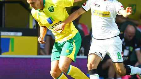 Lukas Rupp battles with Norwich striker Steve Morison during Gladbach's firendly win at Carrow Road