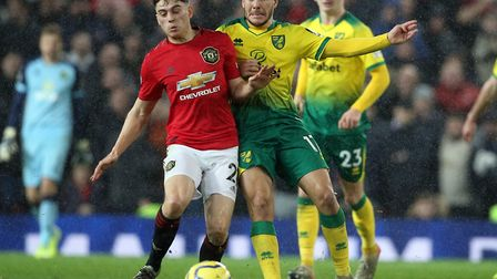 Emi Buendia battles with Dan James during the second half of Norwich City's 4-0 loss at Manchester U