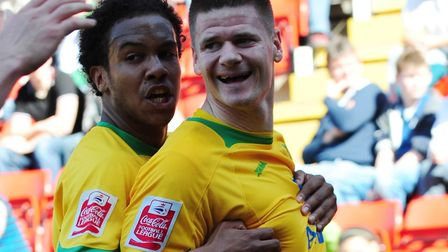 Michael Nelson is congratulated by his Norwich City team-mates after scoring at Charlton in April 20