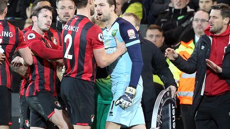 Norwich City keeper Tim Krul was booked for reacting angrily to Bournemouth players trying to get Be
