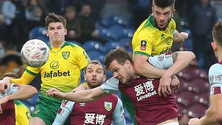 Grant Hanley's thumping header set Norwich City on the way to a 2-1 FA Cup fourth round win at Burnl