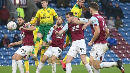 Grant Hanley opened the scoring with a powerful header as Norwich City won at Burnley in the FA Cup