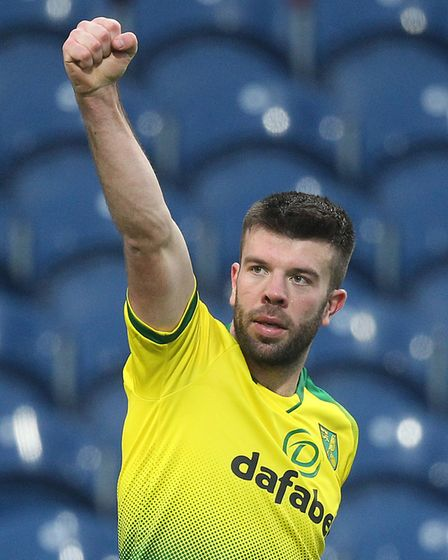 Grant Hanley celebrates opening the scoring at Burnley with Norwich City's travelling supporters Pic