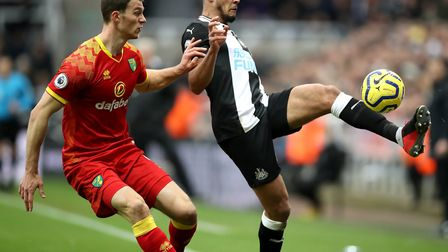 Norwich City's Christoph Zimmermann (left) and Newcastle United's Joelinton battle for the ball duri