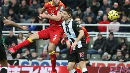 Grant Hanley goes airborne in Norwich City's 0-0 Premier League draw against Newcastle United Pictur