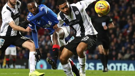 Norwich City defender Akin Famewo, front, in loan action for St Mirren at Rangers last week Picture: