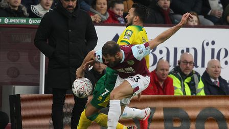 Head coach Daniel Farke watches closely as Lukas Rupp battles with Erik Pieters during Norwich City'