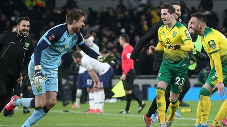 Tim Krul sprints to his Norwich City team-mates to celebrate at Spurs Picture: Paul Chesterton/Focus