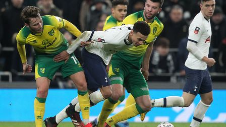 Tom Trybull tussles with Dele Alli in Norwich City's FA Cup tie at Tottenham Picture: Paul Chesterto