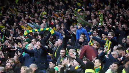 The traveling Norwich fans celebrate victory at the end of the FA Cup match at Tottenham Hotspur Sta