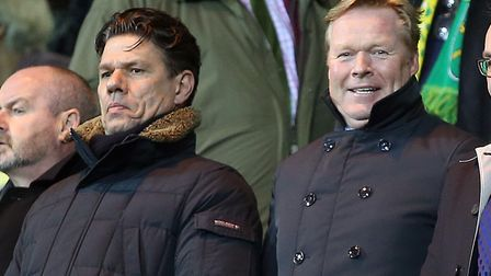 Holland manager Ronald Koeman, centre, alongside his goalkeeper coach Patrick Lodewijks, left, at Ca