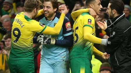 Tim Krul is in the midst of the Norwich City celebrations after the Canaries' breathless FA Cup pena