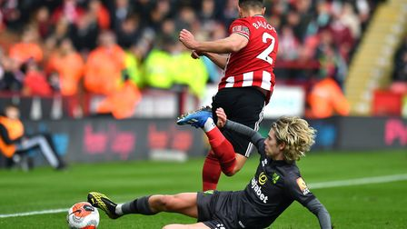 Cantwell and Baldock compete for the ball. Picture: Anthony Devlin/PA Wire