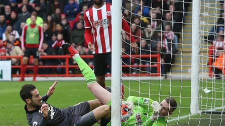 Ben Godfrey's header was this close to going in for Norwich but was stopped by Blades keeper Dean He
