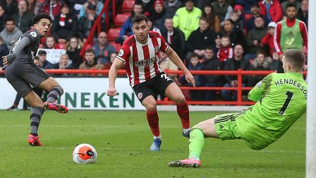 Dean Henderson foils Jamal Lewis in Sheffield United's 1-0 Premier League win over Norwich City Pict