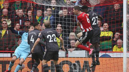 Tim Krul's goal came under constant aerial bombardment during the first half at Bramall Lane Picture