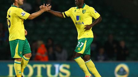 David Fox, left, congratulates Alex Tettey on his debut goal for Norwich City against Doncaster in t