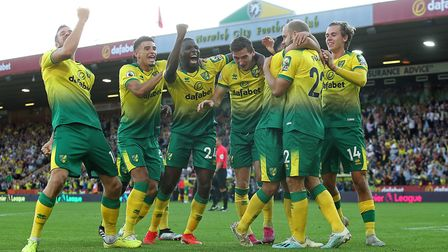 Norwich City players celebrate during their famous 3-2 win over Manchester City, creating a wonderfu