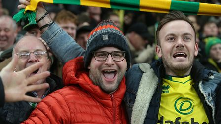 The traveling Norwich fans celebrate their side's 1st goal during the Premier League match at Totten