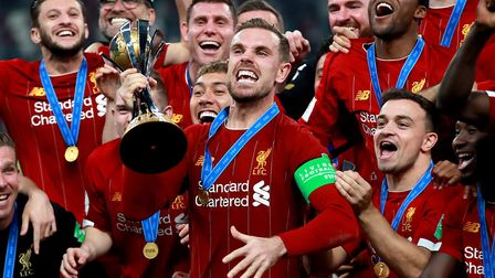 Jordan Henderson, lifting the FIFA Club World Cup in Doha in December, has been a star for Liverpool