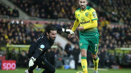 Liverpool keeper Alisson foils Norwich City midfielder Lukas Rupp during the first half at Carrow Ro
