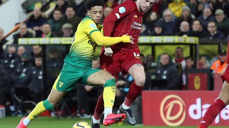 Liverpool captain Jordan Henderson battles with Norwich City left-back Jamal Lewis during the second
