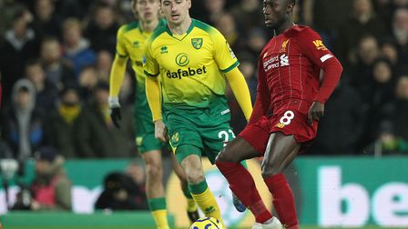 Kenny McLean tracks Naby Keita during Norwich City's 1-0 home defeat to leaders Liverpool Picture: P