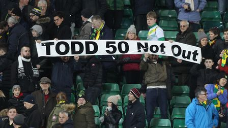 City supporters hold up a banner recognising Todd Cantwell's 50th league appearance for City. Pictur