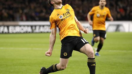 Diogo Jota celebrates the first of his three goals for Wolves during Thursday's victory over Espanyo