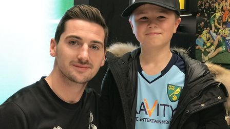 Half term happiness. Charlie Lane, 12 from Norwich meets canary Kenny McLean during an autograph ses
