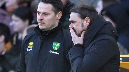 Canaries head coach Daniel Farke, right, and his assistant Eddie Riemer consider their options durin
