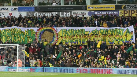 The Norwich fans unfurl a banner commemorating the 40th anniversary of Justin Fashanu's wonder goal