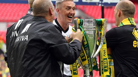 Goalkeeper coach Dean Kiely celebrates Norwich City's Championship play-off final victory with Alex