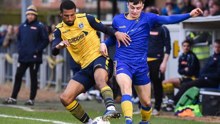 Norwich City loanee Simon Power, right, in action for King's Lynn against Guiseley Picture: Ian Burt