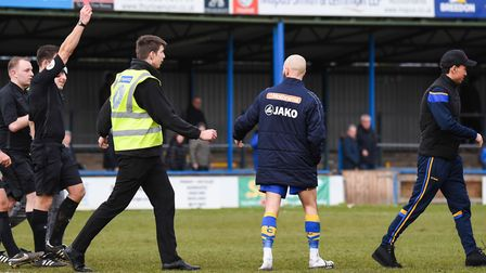 King's Lynn's Michael Clunan (tracksuit) was sent off by the referee after 1-0 defeat to Guiseley. P