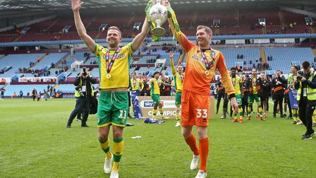 Jordan Rhodes and Michael McGovern lift the Championship trophy at Villa Park. Picture: Paul Cheste