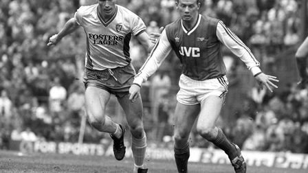 Arsenal's Perry Groves (r) is chased by Norwich City's Andy Linighan (l). Picture: PA Archive/PA Ima