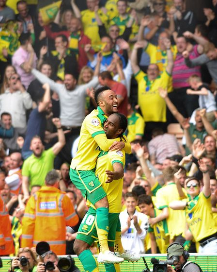 Jumping for joy - Nathan Redmond and scorer Cameron Jerome during the play-off game at Carrow Road P