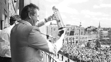 Former Norwich City manager Ken Brown celebrates a promotion with the club at City Hall in 1986. Pic