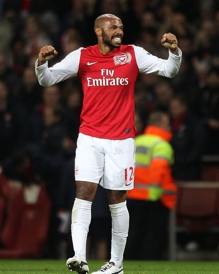 Arsenal's Thierry Henry celebrates victory after the final whistle