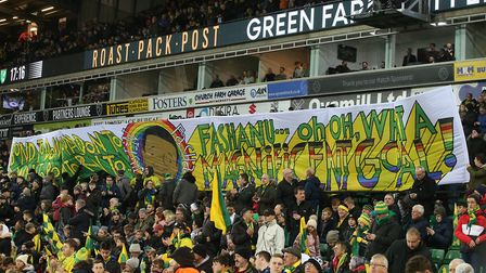 Norwich City fans with their banner commemorating the 40th anniversary of Justin Fashanu's wonder go